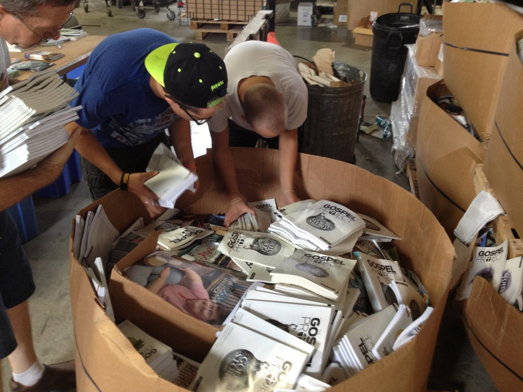 """James and Benjamin sorting through huge boxes of """"damaged"""" literature from publishers."""